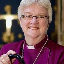 Bishop June Osborne wearing a purple cassock