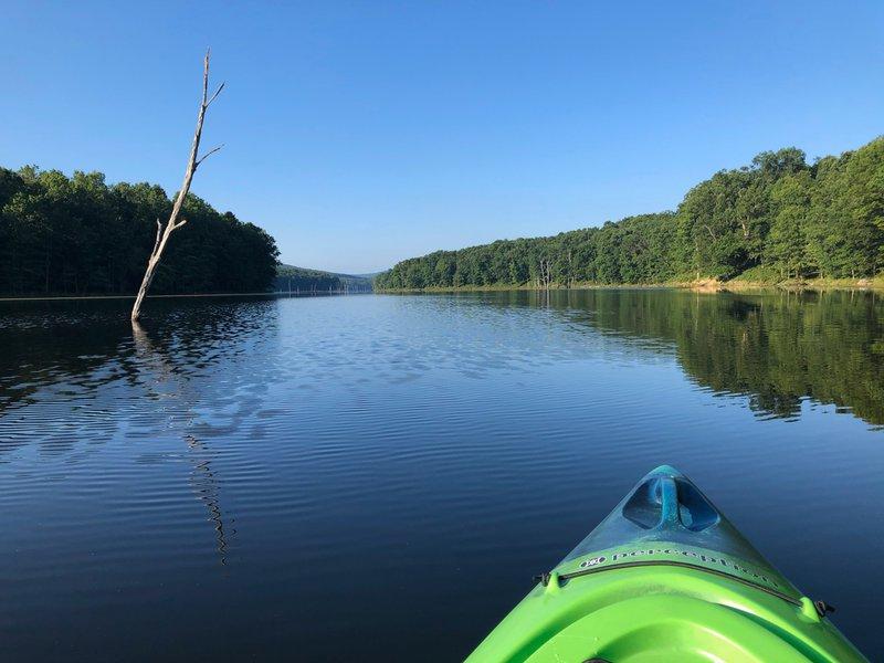Calm water as James' kayaks on Sleepy Creek in West Virginia.