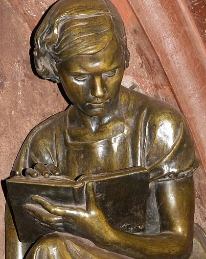 Girl reading sculpture