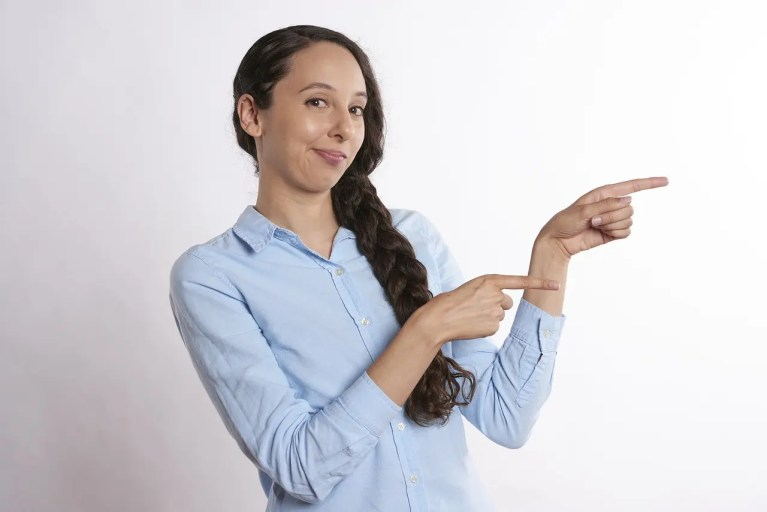 girl pointing to real estate guide