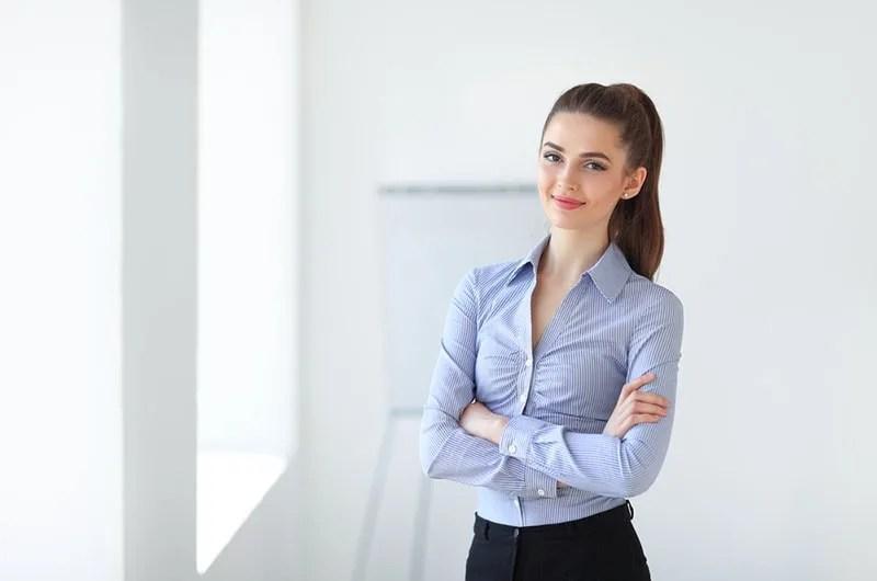 young woman in shirt posing