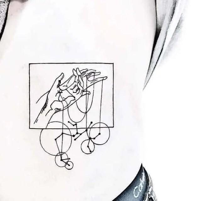 hands holding sagittarius constellation tattoo in the rectangle