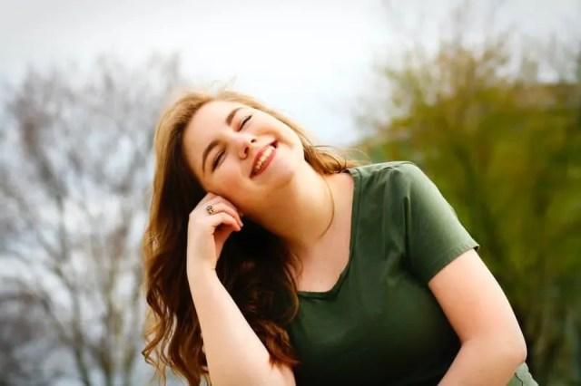 woman in green shirt smiling