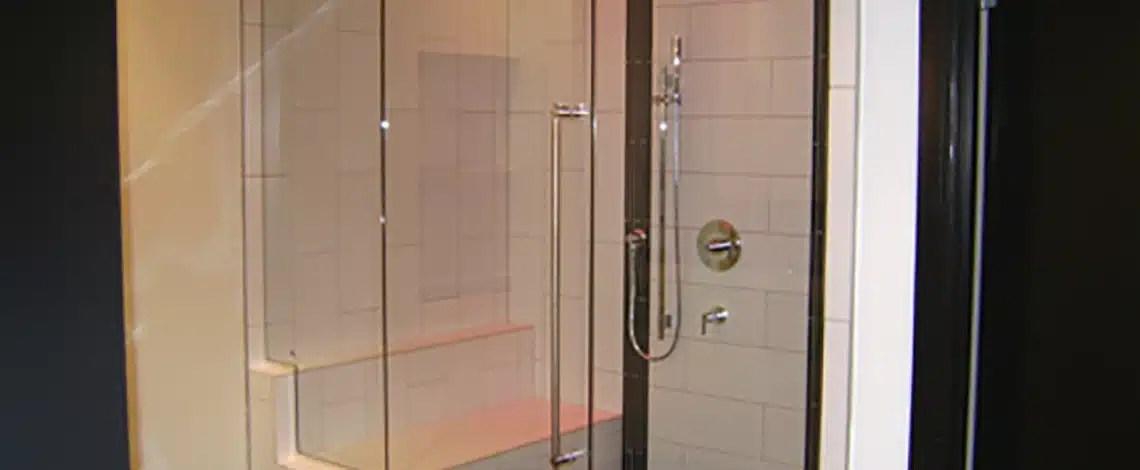 Frameless-Shower-Enclosure-with-Header.Pivot-Tulalip-Casino