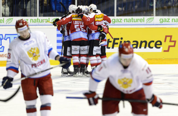 Swiss team players celebrate the second goal during a friendly ice hockey game between Switzerland and Russia, at the ice stadium Les Melezes, in La Chaux-de-Fonds, Switzerland, Friday, April 10, 2015. (PHOTOPRESS/Laurent Gillieron)