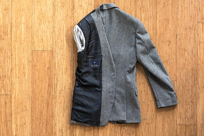 how to fold blazer in suitcase carry on