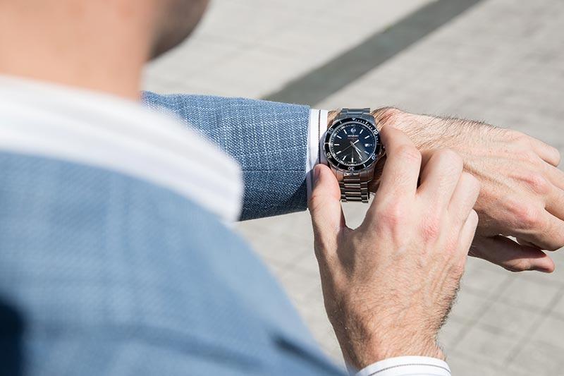 movado-series-800-watch-black-dial-bezel-steel-with-light-blue-linen-blazer-3