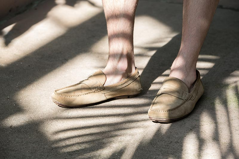 tan-suede-penny-loafers-no-socks-with-palm-tree-shadows