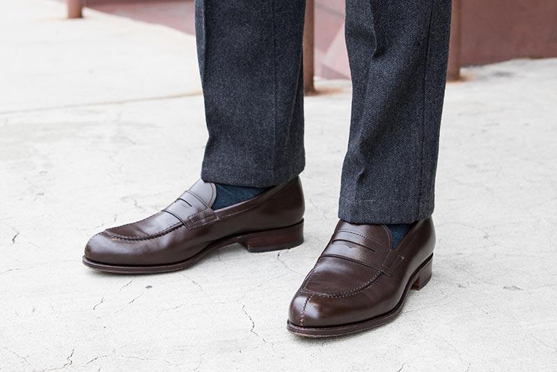 dark-brown-leather-penny-loafers-blue-socks-grey-pants