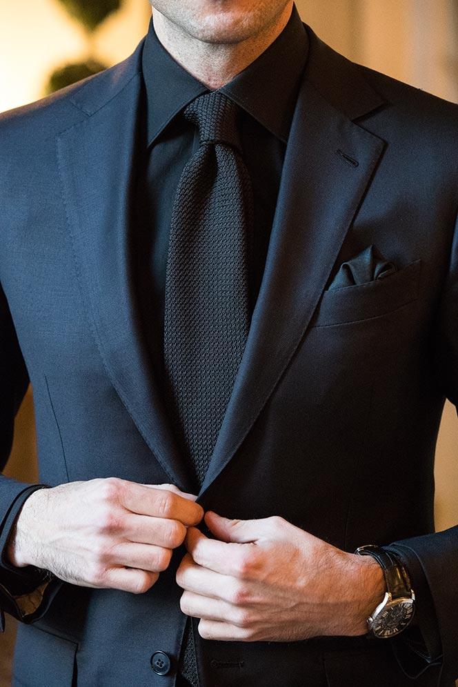 dark-navy-suit-black-shirt-black-tie-alternate-creative-black-tie-dress-code-outfit-ideas-buttoning-suit-jacket-textured