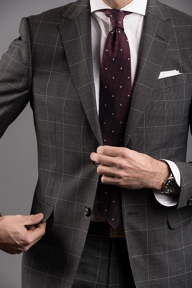 grey-windowpane-plaid-suit-burgundy-tie-with-white-dots-mens-classic-business-outfit-idea-adjusting-pocket-flap-pocket-suit-style
