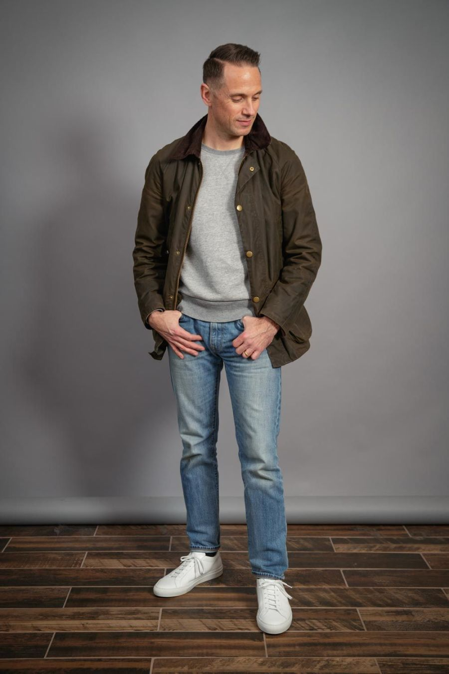 Barbour-waxed-jacket-for-men-heather-grey-casual-sweatshirt-light-wash-jeans-common-projects-sneakers