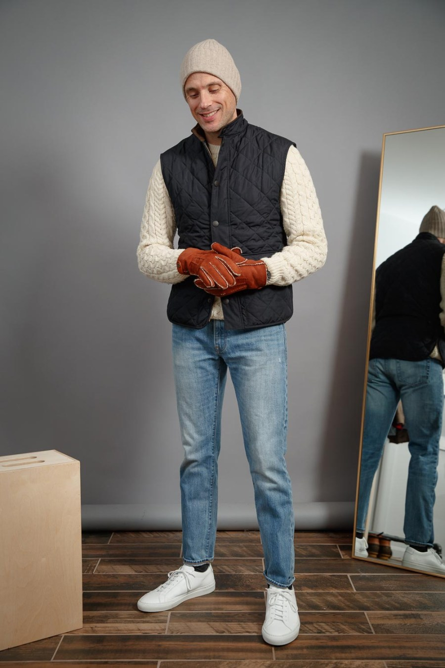 Light-wash-jeans-with-common-projects-sneakers-hilts-willard-gloves-barbour-vest-best-casual-winter-style-ideas