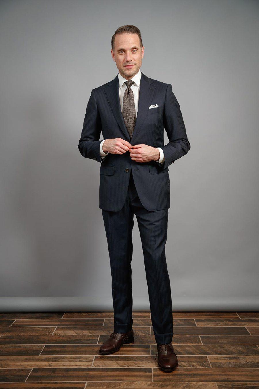 essential-white-poplin-dress-shirt-thomas-mason-navy-herringbone-suit-brown-oxford-shoes-brown-tie