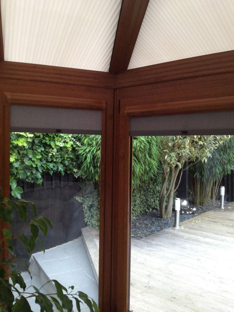 Perfect fit roller blind in golden oak frame