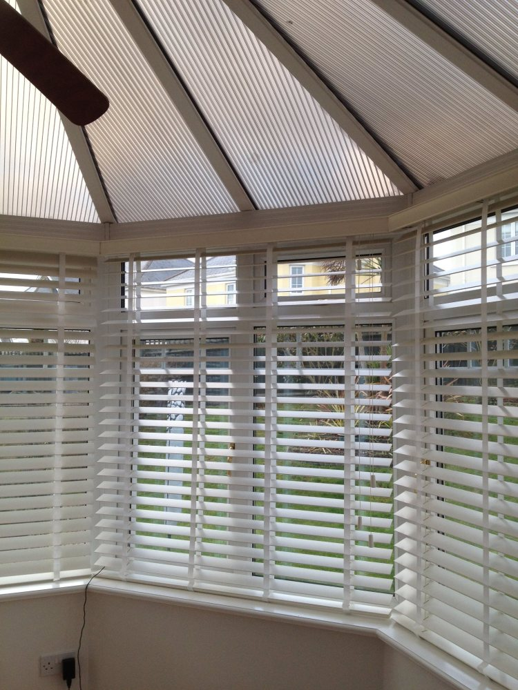 Wooden venetian blinds fitted in conservatory