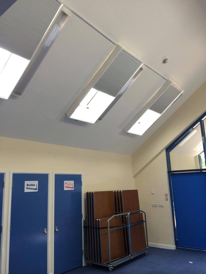 Girl guides and black out pleated roof blinds open