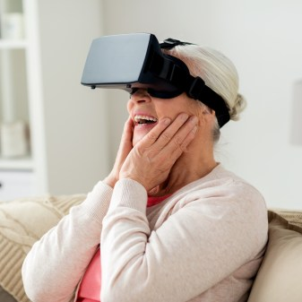 old woman in virtual reality headset or 3d glasses