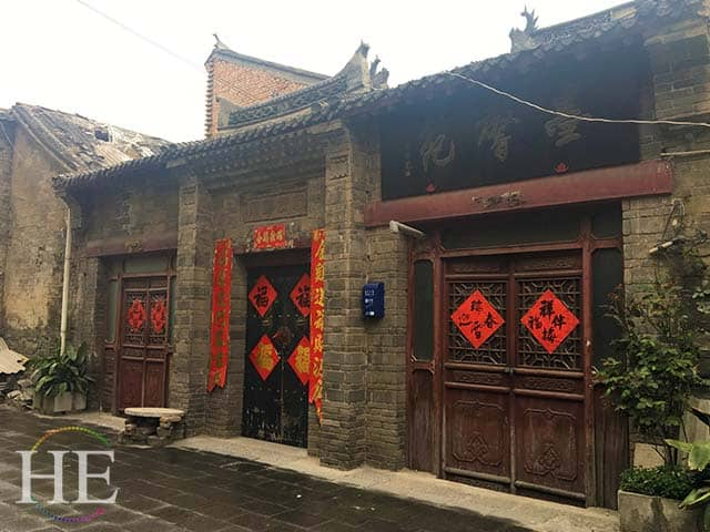 crumbling store fronts in the old city of luoyang china