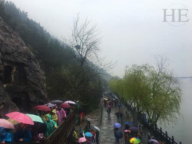 an array of colorful umbrellas on a gloomy day at longmen grottoes in luoyang china