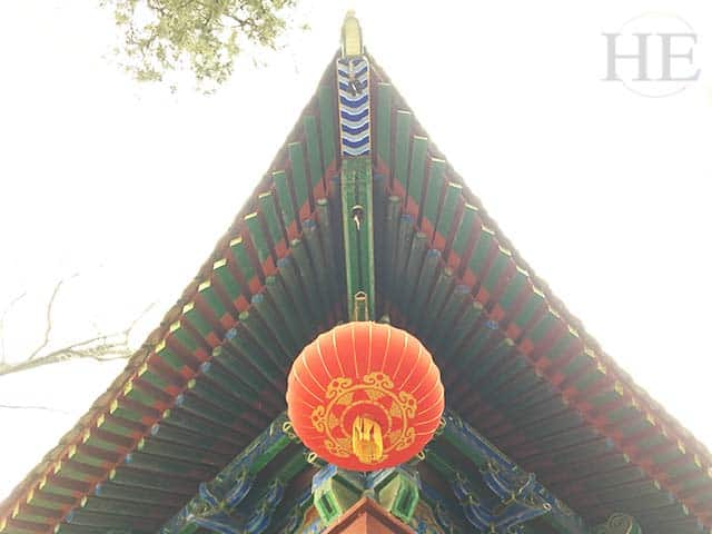 brightly painted pagoda and red hanging lantern at the shaolin temple in china