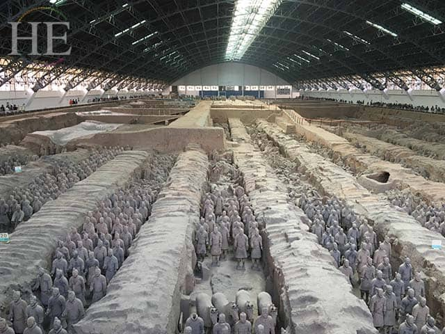 rows of restored soldiers at the terracotta army pits in xi'an china