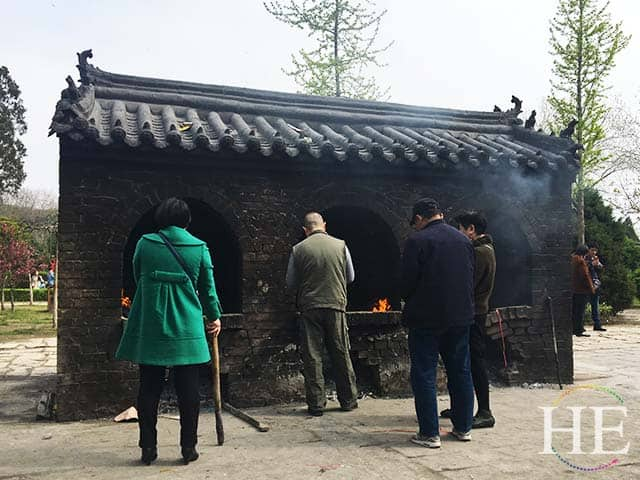 visitors burn fortune papers in a kiln at a park in zhengzhou
