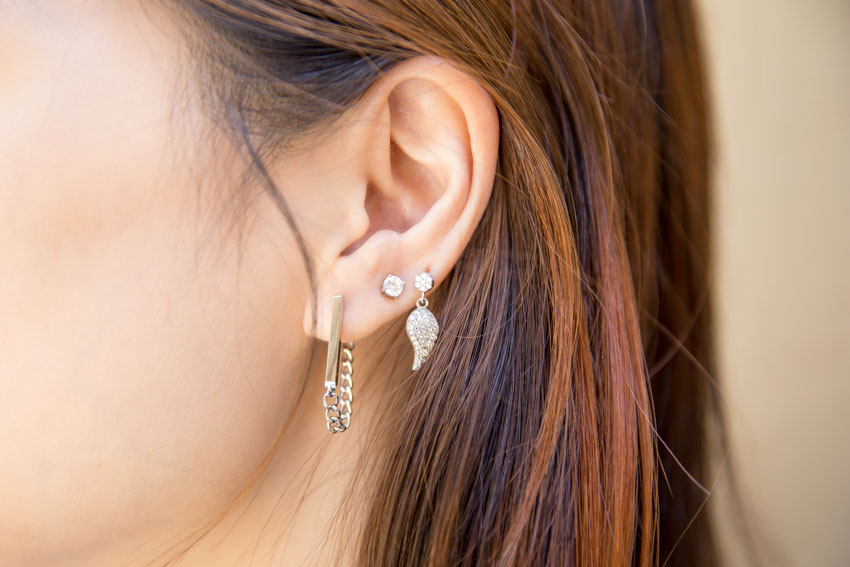 Close up of my left ear with wing earring, stud and bar earring.