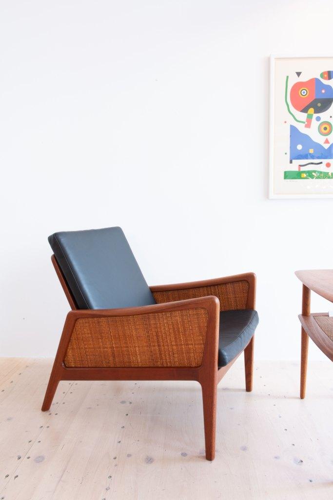 Orla Molgaard-Nielsen & Peter Hvidt FD 151 Lounge Chair in Teak & Cane with Black Leather, by France & Daverkosen, Denmark, 1950s. Available at heyday möbel, Grubenstrasse 19, 8045 Zürich, Switzerland.