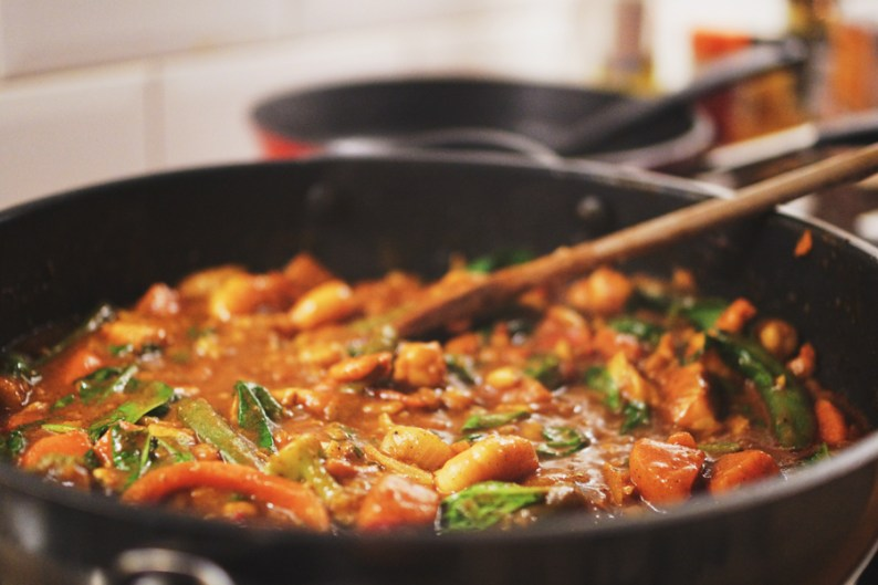 Sweet Potato Fish Curry simmering in pan, created by HDYTI