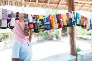 Aiyasha explaining the history of Kanga at the Seaweed Center, Paje, Zanzibar | @dipyourtoesin