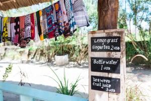 Kangas hanging at the Seaweed Center, Paje, Zanzibar | @dipyourtoesin