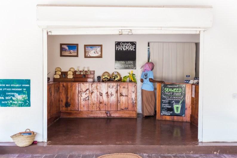 Aysha mans the front shop of the Seaweed Center in PAje, Zanzibar | @dipyourtoesin