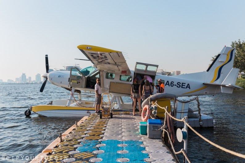 Heading down the pier to board the Cessna at Jebel Ali Golf Resort | @dipyourtoesin