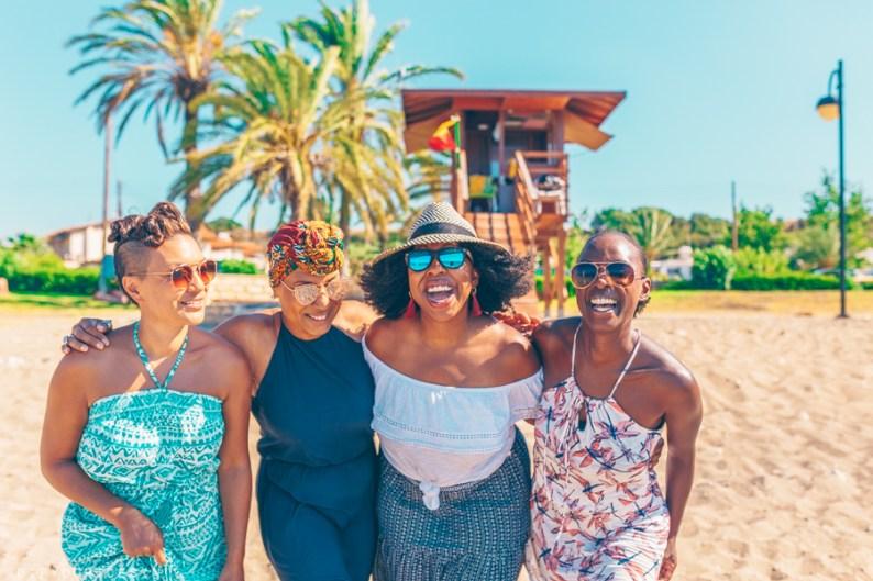 Group smiling on Polis Beach