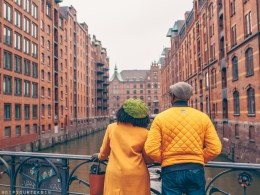 Hamburg photo journal | Black couple looking at warehouses in Speicherstadt, Hamburg