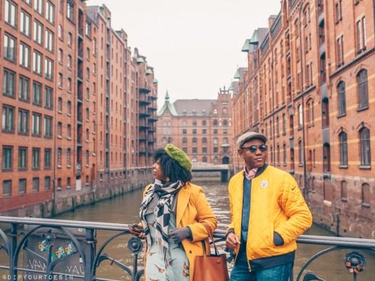 Black couple looking at warehouses in Speicherstadt, Hamburg