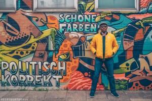 Hamburg photo journal | Man standing in front of street art in Oberhafen
