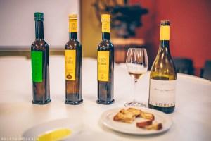 Sampling olive oils produced at Mas Llunes and wine tasting