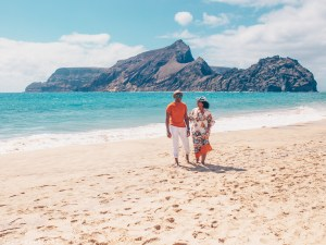 Couple walking on Porto Santo one of the Best Beaches in Europe
