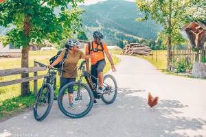 Couple cycling in Leogang, Salzburgerland, Austria