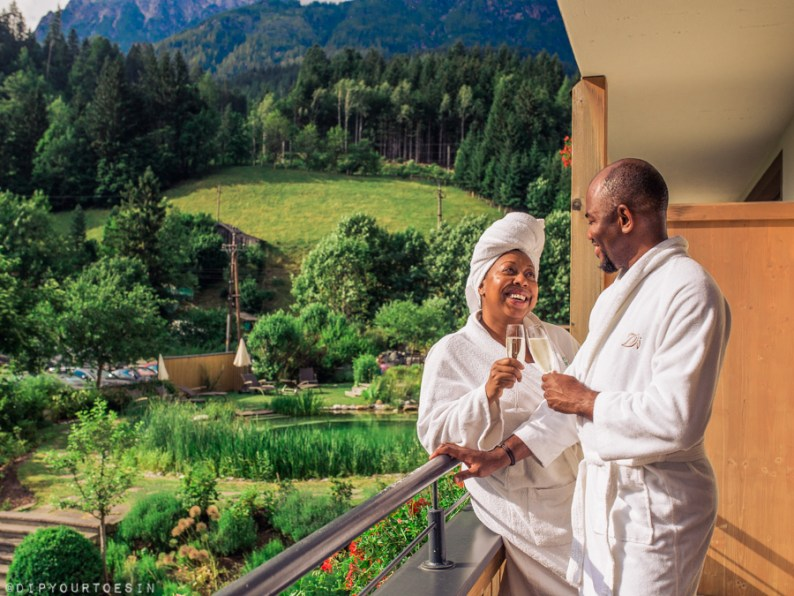 Couple laughing on Balcony in Bio-Hotel Rupertus, Leogang