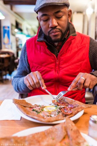Omo eating French crepes at La Galette | Visit Copenhagen