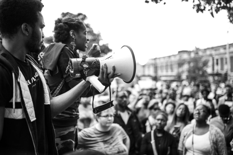 Speaker addressing crowd at London Black Lives Matter Rally, Brixton, London