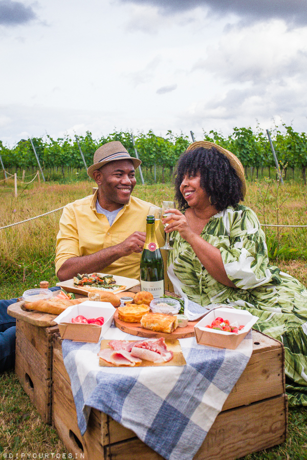 Couple enjoying Picnic in the Vines at Squerryes Wine Estate, Westerham, Kent