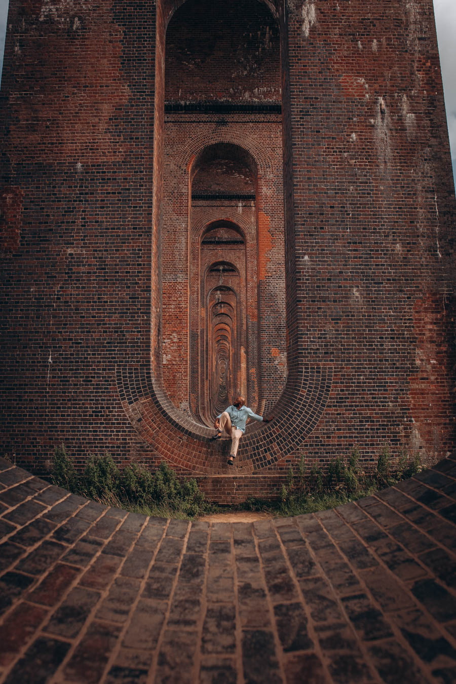 Omo sitting among the arches at the Balcombe Viaduct, West Sussex