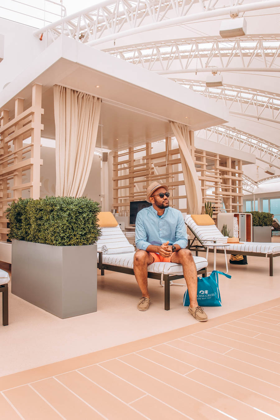 Omo sitting in a cabana in The Sanctuary   Sky Princess by Princess Cruises
