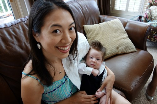 snuggling with ohmygoff's little prince, baby bob iv, at eight weeks old.