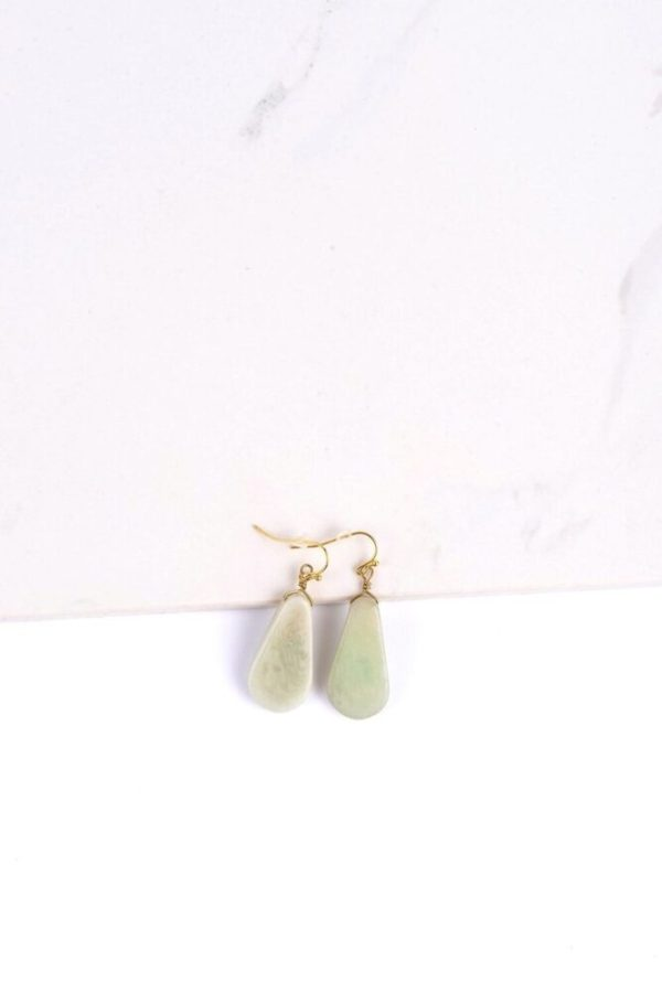 Ethically-sourced Dewkist Contemporary Tagua Stone earrings in white background.