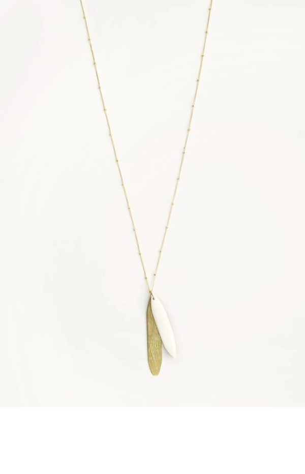 Beautiful 13.5 -15.5 inches Innocent Rustling Necklace with white upcycled bone and brass pendant in white background.